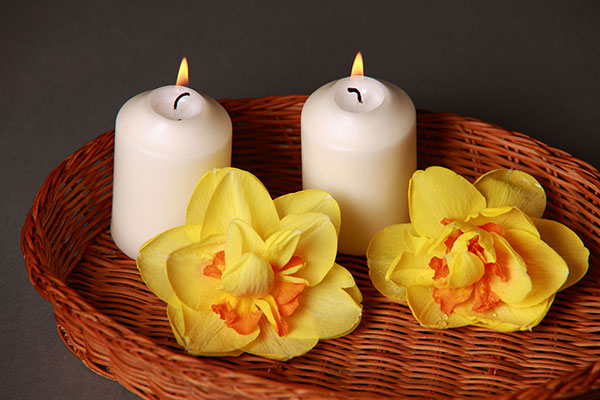 Picture of aromatherapy candles burning and flowers