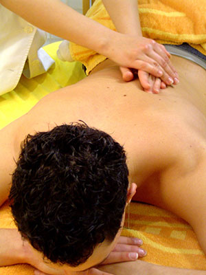 Picture of man getting a soothing, relaxing back massage.