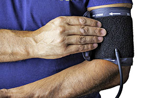 Picture of man checking for high blood pressure