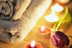 Towels and candles linking stress relief and massage.
