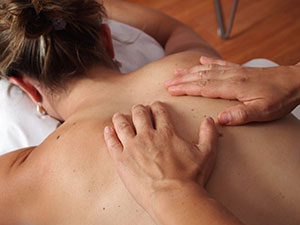 Picture of a woman getting massage treatment to help with her sleep